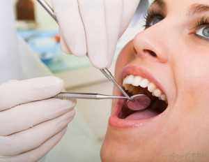 woman-receiving-dental-exam-300x232 Dental Examinations